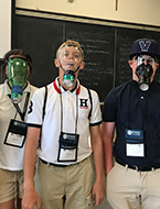 Students wear the breathing apparatuses they worked on during NYLF Explore STEM Alumni