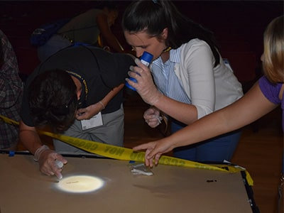 Students process a staged crime scene at NYLF Explore STEM
