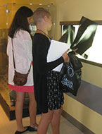 Students look at x-ray images during an NYLF Explore STEM medical simulation