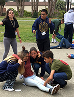 Students participate in a simulation and gain real-world medical skills at NYLF Medicine