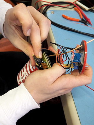 High school student building a can satellite at Rice University's Aerospace & Aviation Academy