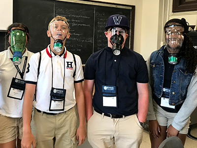 Students wear the breathing apparatuses they worked on during NYLF Explore STEM Alumni's multi-day simulation