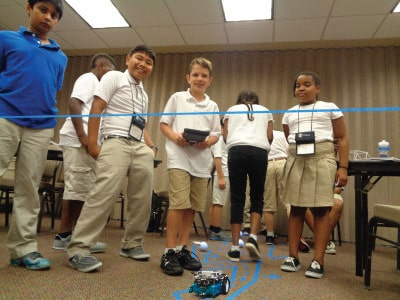 Students test their mBot robot in the Engineering pathway at NYLF Pathways to STEM